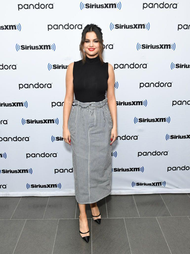 <p>Stopping by Sirius XM's Hits1 at the SiriusXM Studios in New York City wearing a Leset top and Miu Miu skirt.</p>