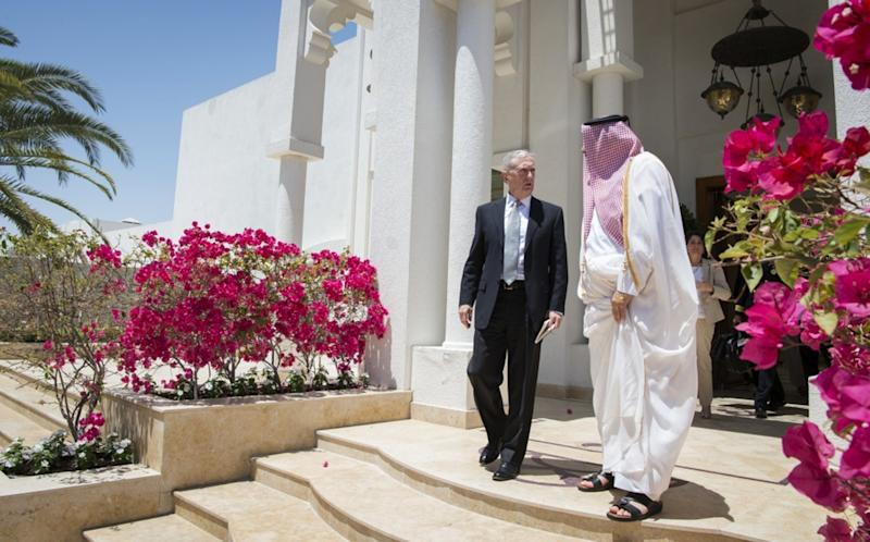 In this April 22, 2017 photo released by the U.S. Defence Department, Secretary of Defense Jim Mattis meets with Qatar's Emir Sheikh Tamim bin Hamad Al Thani at the Sea Palace in Doha, Qatar. A trip by Qatar's ruling emir to a major U.S. military base in his country, Monday, Sept. 11, 2017, has shown the delicate balancing act the U.S. faces in addressing the diplomatic crisis gripping Doha. (US Defence Department/ Brigitte N. Brantley via AP)