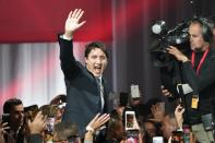 Liberal leader Justin Trudeau waves as he goes on stage at Liberal election headquarters in Montreal, Monday, Oct. 21, 2019. THE CANADIAN PRESS/Paul Chiasson