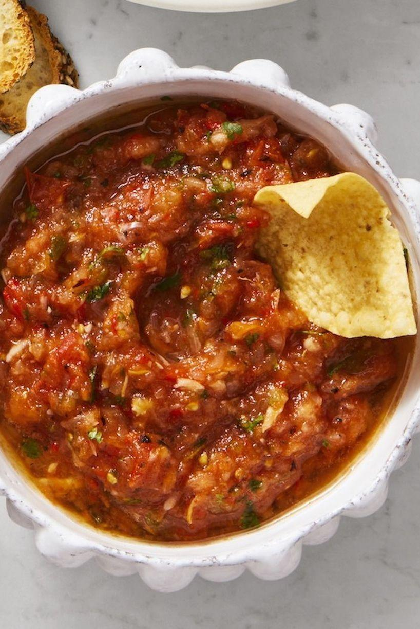 """<p>The key to this authentic salsa is to grill all the ingredients before hand, giving the dip a delicious, smokey flavor.</p><p><em><a href=""""https://www.goodhousekeeping.com/food-recipes/party-ideas/a28507963/charred-salsa-recipe/"""" rel=""""nofollow noopener"""" target=""""_blank"""" data-ylk=""""slk:Get the recipe for Charred Salsa»"""" class=""""link rapid-noclick-resp"""">Get the recipe for Charred Salsa»</a></em></p>"""