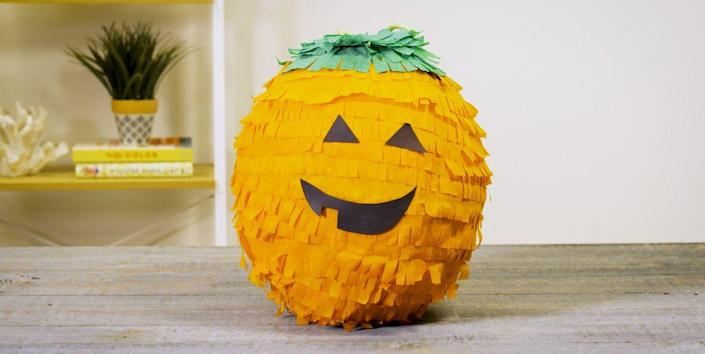 """<p>Your guests will be in for a smashing good time if you put together this pumpkin piñata. </p><p><strong><em>Get the tutorial at <a href=""""https://www.housebeautiful.com/home-remodeling/diy-projects/a23550517/diy-pumpkin-pinata-video-tutorial/"""" rel=""""nofollow noopener"""" target=""""_blank"""" data-ylk=""""slk:House Beautiful"""" class=""""link rapid-noclick-resp"""">House Beautiful</a>. </em></strong></p><p><a class=""""link rapid-noclick-resp"""" href=""""https://www.amazon.com/Crepe-Paper-Streamer-Feet-Piece/dp/B0845MDFRV?tag=syn-yahoo-20&ascsubtag=%5Bartid%7C10070.g.1908%5Bsrc%7Cyahoo-us"""" rel=""""nofollow noopener"""" target=""""_blank"""" data-ylk=""""slk:SHOP ORANGE STREAMERS"""">SHOP ORANGE STREAMERS</a></p>"""