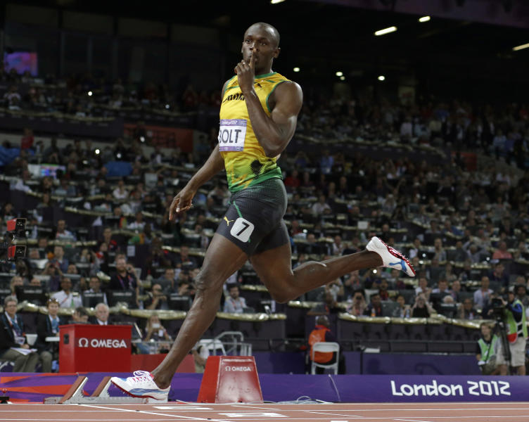 Jamaica's Usain Bolt gestures as he crosses the finish line to win gold in the men's 200-meter final during the athletics in the Olympic Stadium at the 2012 Summer Olympics, London, Thursday, Aug. 9, 2012. (AP Photo/David J. Phillip)