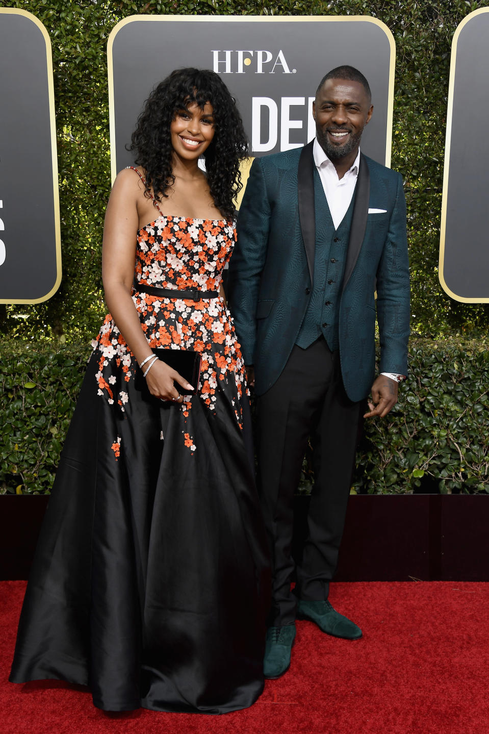 <p>Idris Elba eschewed the traditional tux in favour of an forest green suit by Ozwald Boateng at the 2019 Golden Globe Awards. <em>[Photo: Getty]</em> </p>