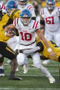 Mississippi quarterback John Rhys Plumlee runs between Missouri defenders during the first quarter of an NCAA college football game Saturday, Oct. 12, 2019, in Columbia, Mo. (AP Photo/L.G. Patterson)