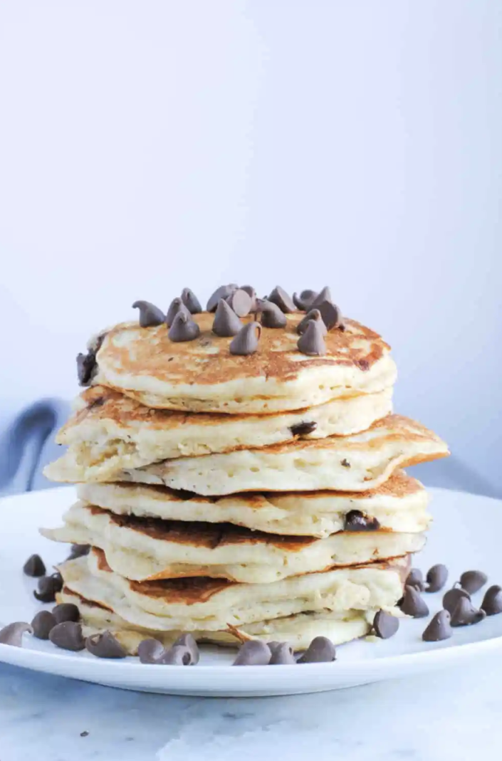 """<p>You already know chocolate chips are great cooked in pancakes. Why not throw a handful on top, too? </p><p><strong>Get the recipe from <a href=""""https://neveranythyme.com/buttermilk-pancakes-christmas-in-connecticut/"""" rel=""""nofollow noopener"""" target=""""_blank"""" data-ylk=""""slk:Never Any Thyme"""" class=""""link rapid-noclick-resp"""">Never Any Thyme</a>. </strong></p><p><strong><a class=""""link rapid-noclick-resp"""" href=""""https://go.redirectingat.com?id=74968X1596630&url=https%3A%2F%2Fwww.walmart.com%2Fc%2Fkp%2Fchocolate-chips&sref=https%3A%2F%2Fwww.thepioneerwoman.com%2Ffood-cooking%2Fmeals-menus%2Fg36146701%2Fbest-pancake-toppings%2F"""" rel=""""nofollow noopener"""" target=""""_blank"""" data-ylk=""""slk:SHOP CHOCOLATE CHIPS"""">SHOP CHOCOLATE CHIPS</a><br></strong></p>"""