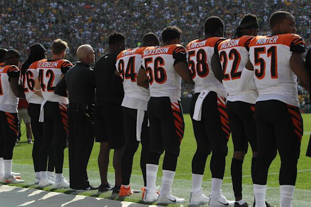 <p>Members of the Cincinnati Bengals stand with arms locked as a sign of unity during the national anthem prior to their game against the Green Bay Packers at Lambeau Field on September 24, 2017 in Green Bay, Wisconsin. (Photo by Dylan Buell/Getty Images) </p>