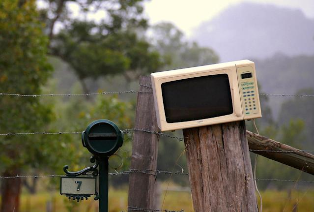 <p>An old microwave repurposed a mailbox sits next to a more traditional box in the outskirts of Wollombi township, north of Sydney, Australia. (Photo: David Gray/Reuters) </p>