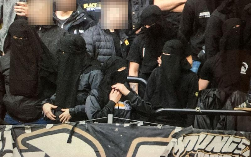 Fans of Swedish club AIK have adpoted the Islamic headdress to get around a new law