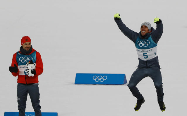 Nordic Combined Events - Pyeongchang 2018 Winter Olympics - Men's Individual 10 km Final - Alpensia Cross-Country Skiing Centre - Pyeongchang, South Korea - February 20, 2018 - Gold medalist, Johannes Rydzek of Germany celebrates as silver medalist, Fabian Riessle of Germany applauds during the victory ceremony. REUTERS/Dominic Ebenbichler