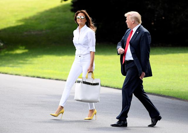 U.S. President Donald Trump and First Lady Melania Trump walk to Marine One upon departure from the White House, in Washington, U.S., July 27, 2018. (Photo: REUTERS/Mary F. Calvert_