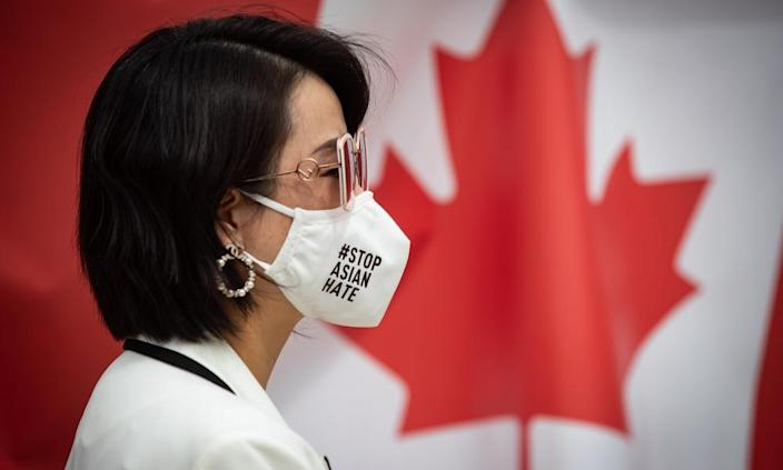 Linda Li, president of the Tri-City Chinese Community Society, wears a face mask that says 'Stop Asian hate' in Richmond.