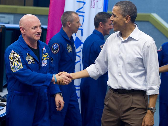 <p>Mark Kelly meets Barack Obama at the Kennedy Space Centre in Florida</p>AFP via Getty Images