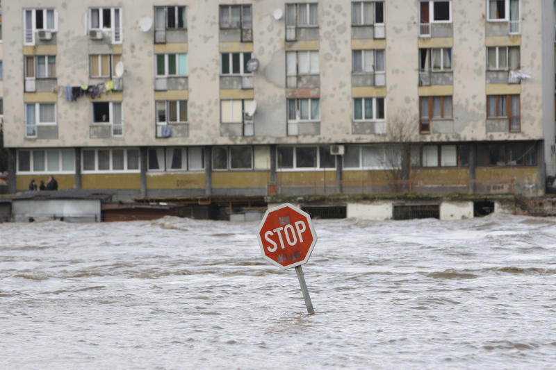 Traffic sign is seen on a road flooded with water from the river Drina, in Gorazde, Bosnia, Thursday, Dec. 2, 2010. Authorities have declared a state of emergency and are evacuating people after heavy rainfall caused floods in several areas of Bosnia. (AP Photo/Amel Emric)