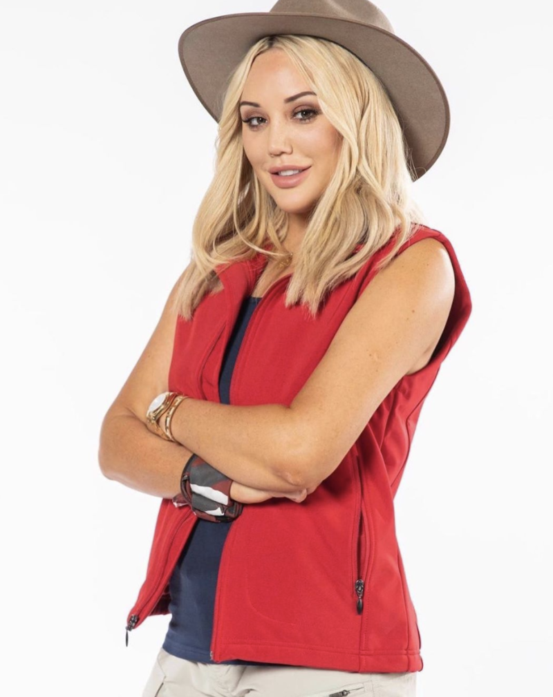 Charlotte Crosby poses in akubra and red vest for I'm a Celeb Australia