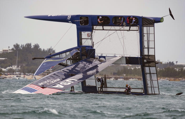In this photo provided by SailGP, the USA SailGP Team, helmed by Jimmy Spithill, is capsized during the first race on race Day 2 of the Bermuda SailGP event in Hamilton, Bermuda, Sunday, April 25, 2021. (Bob Martin/SailGP via AP)