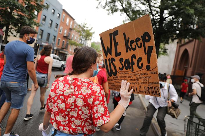 Members of the teachers union, parents and students participate in a march through Brooklyn, New York, on Sept. 1 to demand a safer teaching environment for themselves and students during the COVID-19 pandemic. (Photo: Spencer Platt via Getty Images)