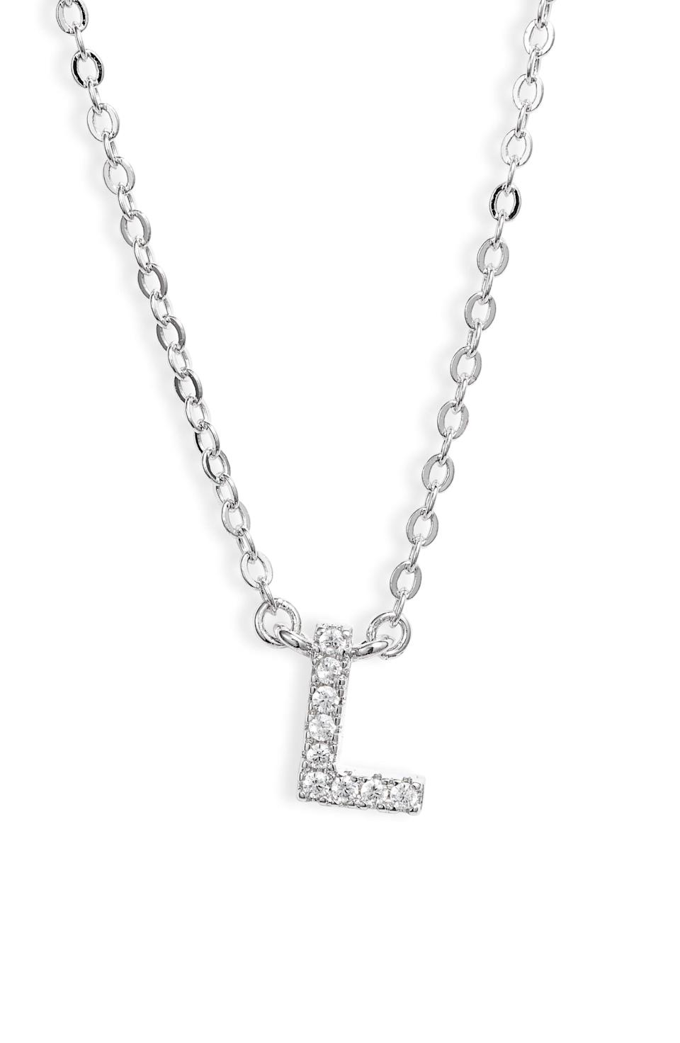 """<p>Make them feel special with this <a href=""""https://www.popsugar.com/buy/Delicate-Cubic-Zirconia-Initial-Pendant-Necklace-569760?p_name=Delicate%20Cubic%20Zirconia%20Initial%20Pendant%20Necklace&retailer=shop.nordstrom.com&pid=569760&price=45&evar1=moms%3Aus&evar9=32519221&evar98=https%3A%2F%2Fwww.popsugar.com%2Ffamily%2Fphoto-gallery%2F32519221%2Fimage%2F32519259%2FDelicate-Cubic-Zirconia-Initial-Pendant-Necklace&list1=gifts%2Choliday%2Cgift%20guide%2Cgifts%20for%20kids%2Ckid%20shopping%2Ctweens%20and%20teens%2Choliday%20for%20kids%2Cgifts%20for%20teens&prop13=api&pdata=1"""" class=""""link rapid-noclick-resp"""" rel=""""nofollow noopener"""" target=""""_blank"""" data-ylk=""""slk:Delicate Cubic Zirconia Initial Pendant Necklace"""">Delicate Cubic Zirconia Initial Pendant Necklace </a> ($45).</p>"""