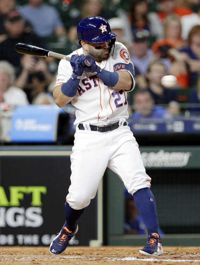 Houston Astros second baseman Jose Altuve (27) tries to duck before getting hit by a pitch from Kansas City Royals starter Jakob Junis during the third inning of a baseball game Monday, May 6, 2019, in Houston. (AP Photo/Michael Wyke)