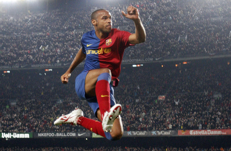 Barcelona's Thierry Henry celebrates a goal against Malaga at the Nou Camp Stadium in Barcelona in 2009