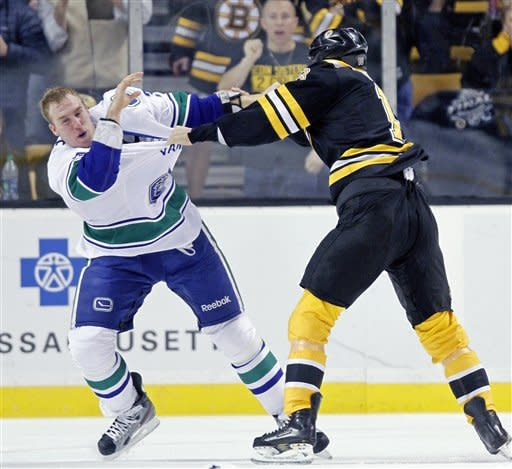 Boston Bruins' Nathan Horton, right, and Vancouver Canucks' Dale Weise, left, fight in the first period of an NHL hockey game in Boston, Saturday, Jan. 7, 2012. (AP Photo/Michael Dwyer)