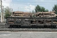 <p>A train pulls along the tracks holding nothing but wooden logs. Wood products are one of the most heavily-exported objects from North Korea, as well as coal and knitted clothing. (Getty) </p>