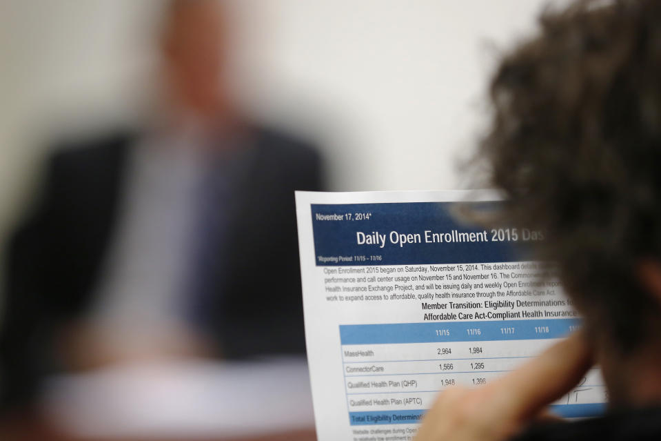 """A reporter reads a summary of the performance and usage over the first two days of open enrollment of the Massachusetts Health Connector website, the state's health insurance website under the Affordable Care Act or Obamacare, during a briefing for reporters in Boston, Massachusetts November 17, 2014.  U.S. President Barack Obama on Sunday defended the transparency of his signature healthcare law, after one of the White House's advisors on the reform said the law passed, in part, because of the """"stupidity"""" of the American voters.        REUTERS/Brian Snyder    (UNITED STATES - Tags: HEALTH POLITICS)"""