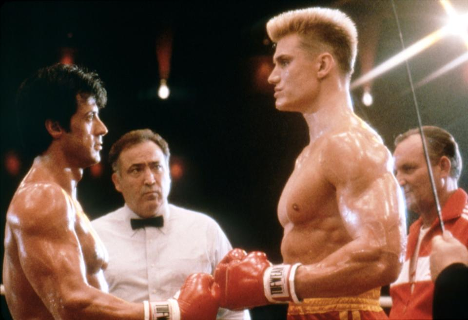 """Sylvester Stallone and Dolph Lundgren face off on the set of """"Rocky IV."""" (Photo: Sunset Boulevard via Getty Images)"""