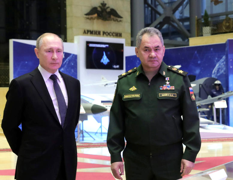 Russian President Vladimir Putin, left, and Defense Minister Sergei Shoigu speaks to journalists after attending an annual meeting with top military officials in the National Defense Control Center in Moscow, Russia, Tuesday, Dec. 24, 2019.Putin said that Russia is the only country in the world that has hypersonic weapons even though its military spending is a fraction of the U.S. military budget. (Mikhail Klimentyev, Sputnik, Kremlin Pool Photo via AP)