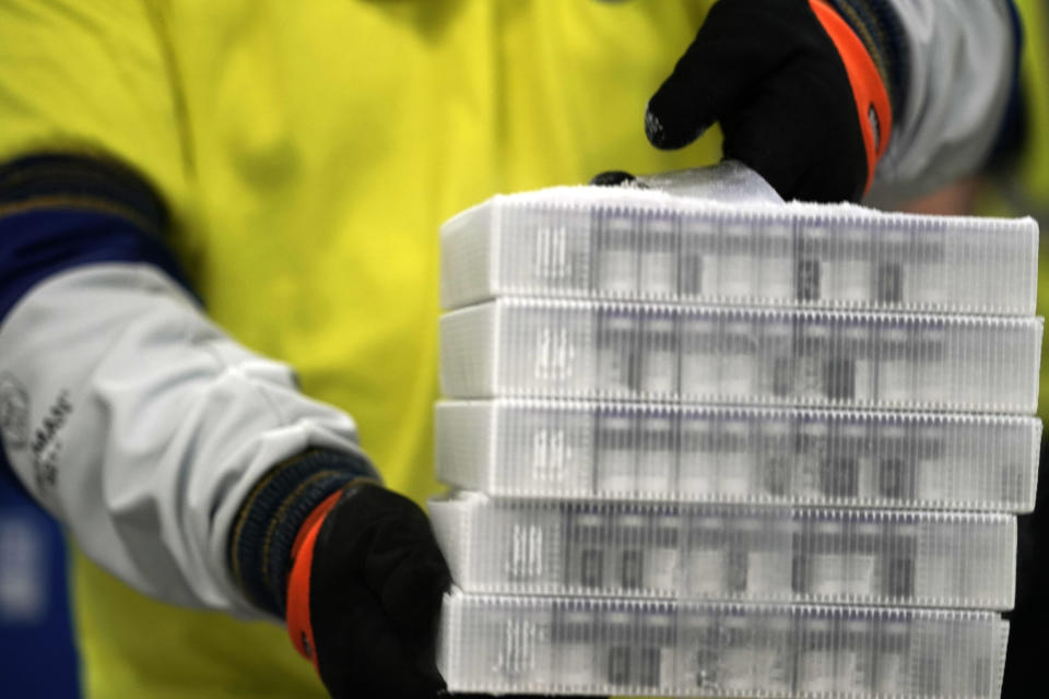 Boxes containing the Pfizer-BioNTech COVID-19 vaccine are prepared to be shipped at the Pfizer Global Supply Kalamazoo manufacturing plant in Portage, Mich., Sunday, Dec. 13, 2020. (AP Photo/Morry Gash, Pool)