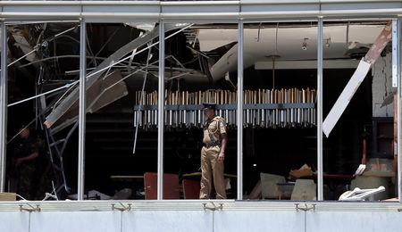 A police officer inspects the explosion area at Shangri-La hotel in Colombo, Sri Lanka April 21, 2019. REUTERS/Dinuka Liyanawatte