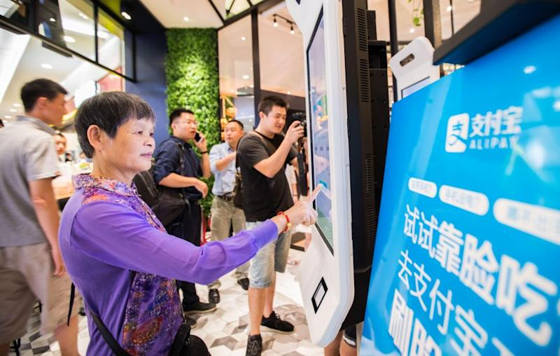 Customers simply scan their faces when placing an order at a kiosk, which will then prompt them to enter a phone number. Source: Getty