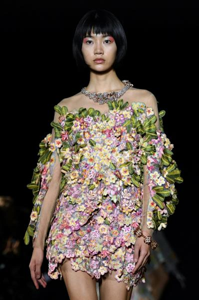"A ""jungle dress"" embroidered with hundreds of flowers in Mishra's debut Paris haute couture show"
