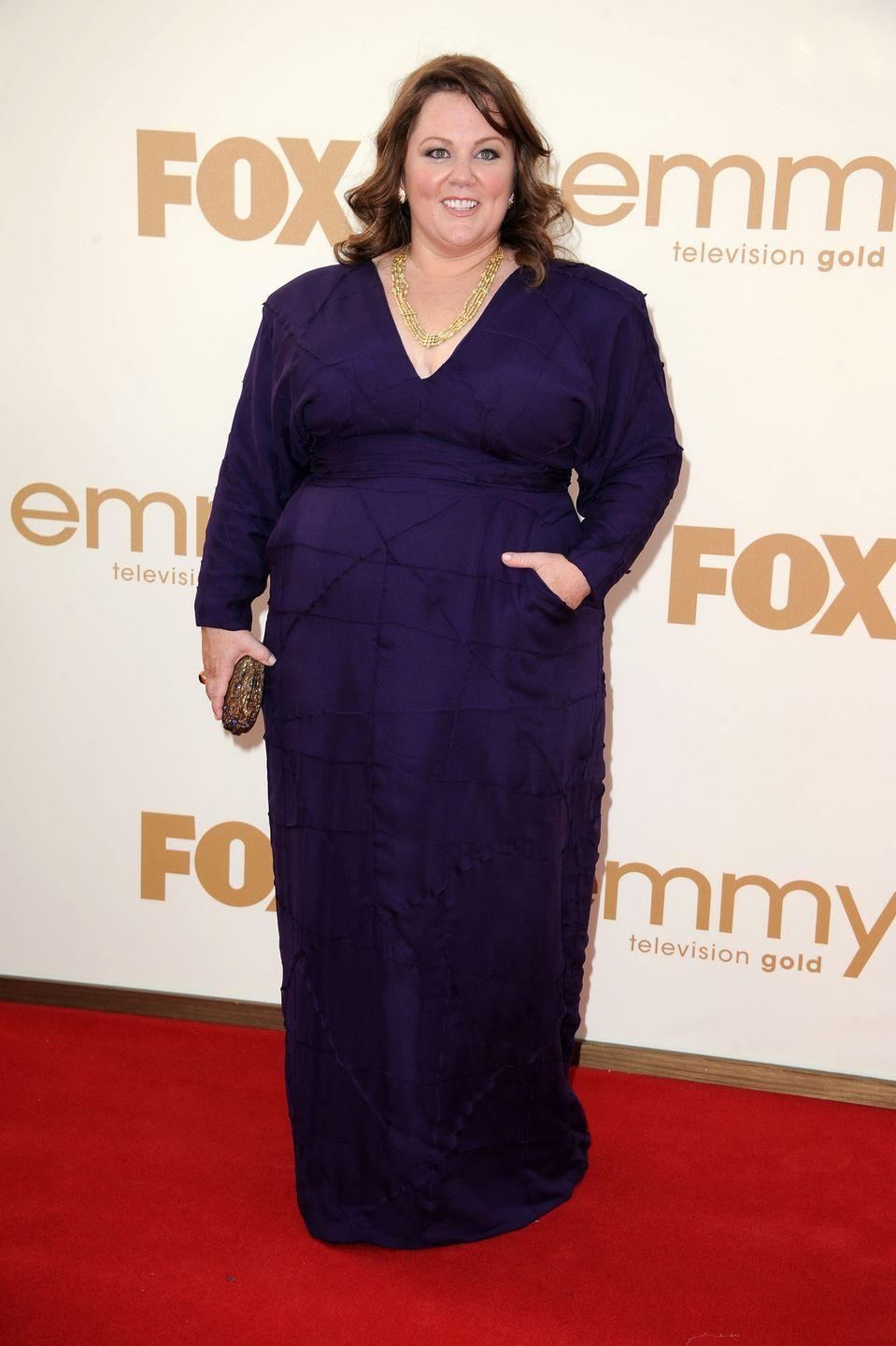 """<p>McCarthy wore this gorgeous purple gown when she won her Emmy for <em>Mike & Molly</em><span class=""""redactor-invisible-space""""> in 2011. </span></p>"""