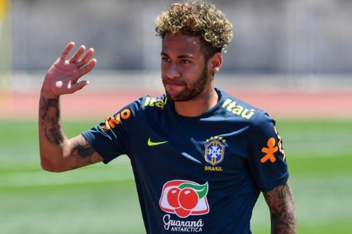 Brazil striker Neymar greets supporters during a training session in Sochi