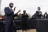 Georgia Democratic candidate for U.S. Senate Raphael Warnock, left, applauds as President-elect Joe Biden speaks at a drive-in rally for Warnock and Jon Ossoff, Tuesday, Dec. 15, 2020, in Atlanta. Standing with Warnock are Stacey Abrams, center, and Georgia Democratic candidates for U.S. Senate Jon Ossoff. (AP Photo/Patrick Semansky)