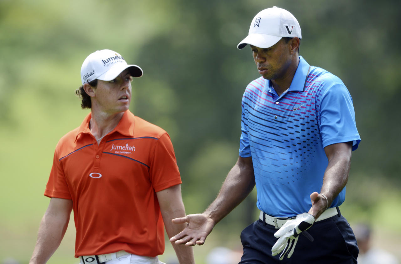 Tiger Woods, right, and Rory McIlroy of Northern Ireland, walk off the second tee during the second round of The Barclays golf tournament at Bethpage State Park in Farmingdale, N.Y., Friday, Aug. 24, 2012. (AP Photos/Henny Ray Abrams)