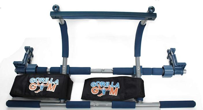 """This is not your average pull-up bar. Offering many more options, this sturdy <a href=""""https://www.amazon.com/dp/B00FM62GCW/"""" rel=""""nofollow noopener"""" target=""""_blank"""" data-ylk=""""slk:Gorilla Gym unit"""" class=""""link rapid-noclick-resp"""">Gorilla Gym unit</a> gives you the ability to do any range of pull-ups (more hand positions, safer swinging) and includes accessories for mounting aerial yoga straps, punching bags, and even an entire kids playground with a swing, rings, and a ladder. The equipment rests above your door without the need for drilling or hardware but still has added stability with adjustable vise clamps that attach to the sides of your doorframe. You'll get a great workout and also have the ability to take the whole thing down with ease."""