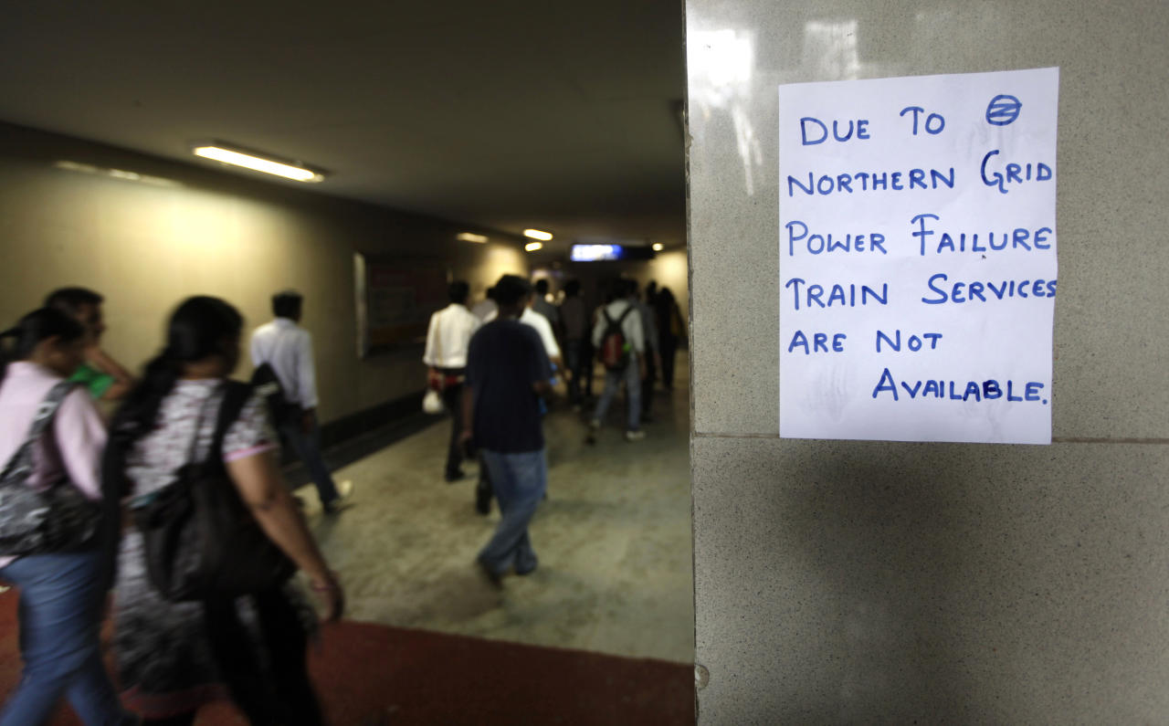 A handwritten notice about power failure is pasted outside a Metro station after Delhi Metro rail services were disrupted following power outage in New Delhi, India, Tuesday, July 31, 2012. India's energy crisis cascaded over half the country Tuesday when three of its regional grids collapsed, leaving more than 600 million people without government-supplied electricity in one of the world's biggest-ever blackouts.(AP Photo/ Manish Swarup)