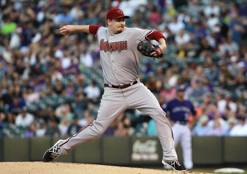 Arizona Diamondbacks starting pitcher Trevor Cahill works against the Colorado Rockies in the first inning of a baseball game in Denver on Saturday, Sept. 21, 2013. (AP Photo/David Zalubowski)