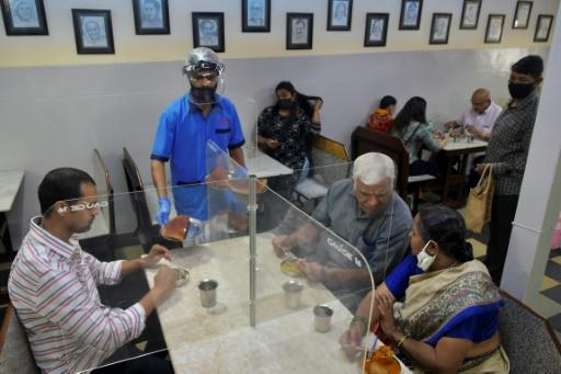 Customers in Bangalore restaurants sat at tables divided by screens