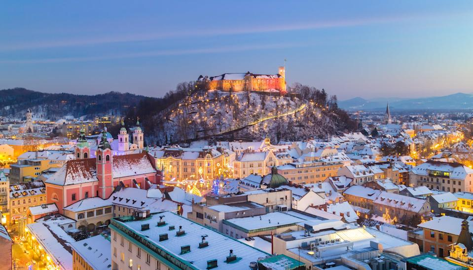 """<a href=""""https://www.cntraveler.com/gallery/best-places-to-visit-in-slovenia/?mbid=synd_yahoo_rss"""" rel=""""nofollow noopener"""" target=""""_blank"""" data-ylk=""""slk:Slovenia"""" class=""""link rapid-noclick-resp"""">Slovenia</a>'s capital city is a real-life fairytale setting, come sunshine or snow flurries. Visit during December to see the Baroque architecture surrounded by Christmas lights; or dodge the crowds and book a trip after the holidays, when you'll have tons of room to stroll the pedestrian-only Old Town and sip coffee by the riverside cafés. You can also add <a href=""""https://www.cntraveler.com/story/why-your-next-european-road-trip-should-be-in-slovenia?mbid=synd_yahoo_rss"""" rel=""""nofollow noopener"""" target=""""_blank"""" data-ylk=""""slk:Lake Bled"""" class=""""link rapid-noclick-resp"""">Lake Bled</a> and the Julian Alps to your itinerary, as Ljubljana makes the perfect base for Slovenian day trips."""