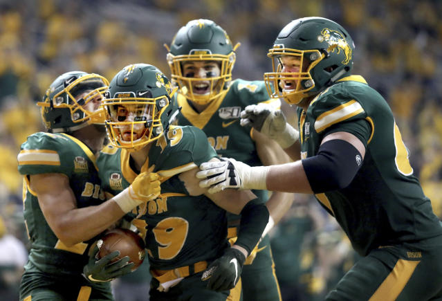 North Dakota State wide receiver Jimmy Kepouros (19) celebrates with teammates after scoring a touchdown during the FCS playoff NCAA college football game against Montana State, Saturday, Dec. 21, 2019, in Fargo, N.D. (AP Photo/Bruce Crummy)