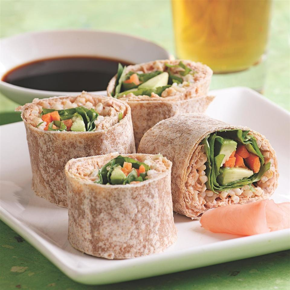 <p>These tuna wraps were inspired by spicy tuna sushi rolls. We love how they taste with peppery watercress, but other greens, such as arugula, romaine, escarole or even radish sprouts, would taste great in the filling. If you want to play on the sushi inspiration, stir some wasabi into the soy sauce for dipping and serve with pickled ginger. Serve with sliced cucumbers and slivered red onions tossed with rice vinegar, a little oil and a pinch of salt.</p>