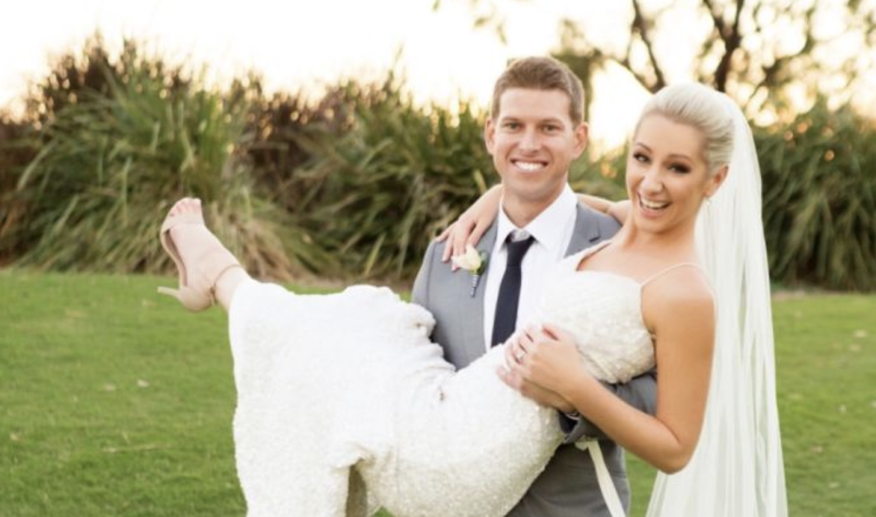 Ashleigh Conwell is pictured with husband Matt on their wedding day.