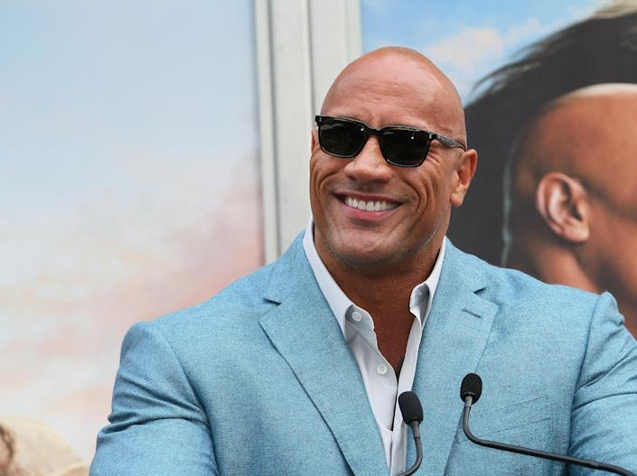 Dwayne Johnson attends a Hand and Footprint ceremony honoring Kevin Hart at the TCL Chinese Theatre IMAX on December 10, 2019. (Jean Baptiste Lacroix/Getty Images)