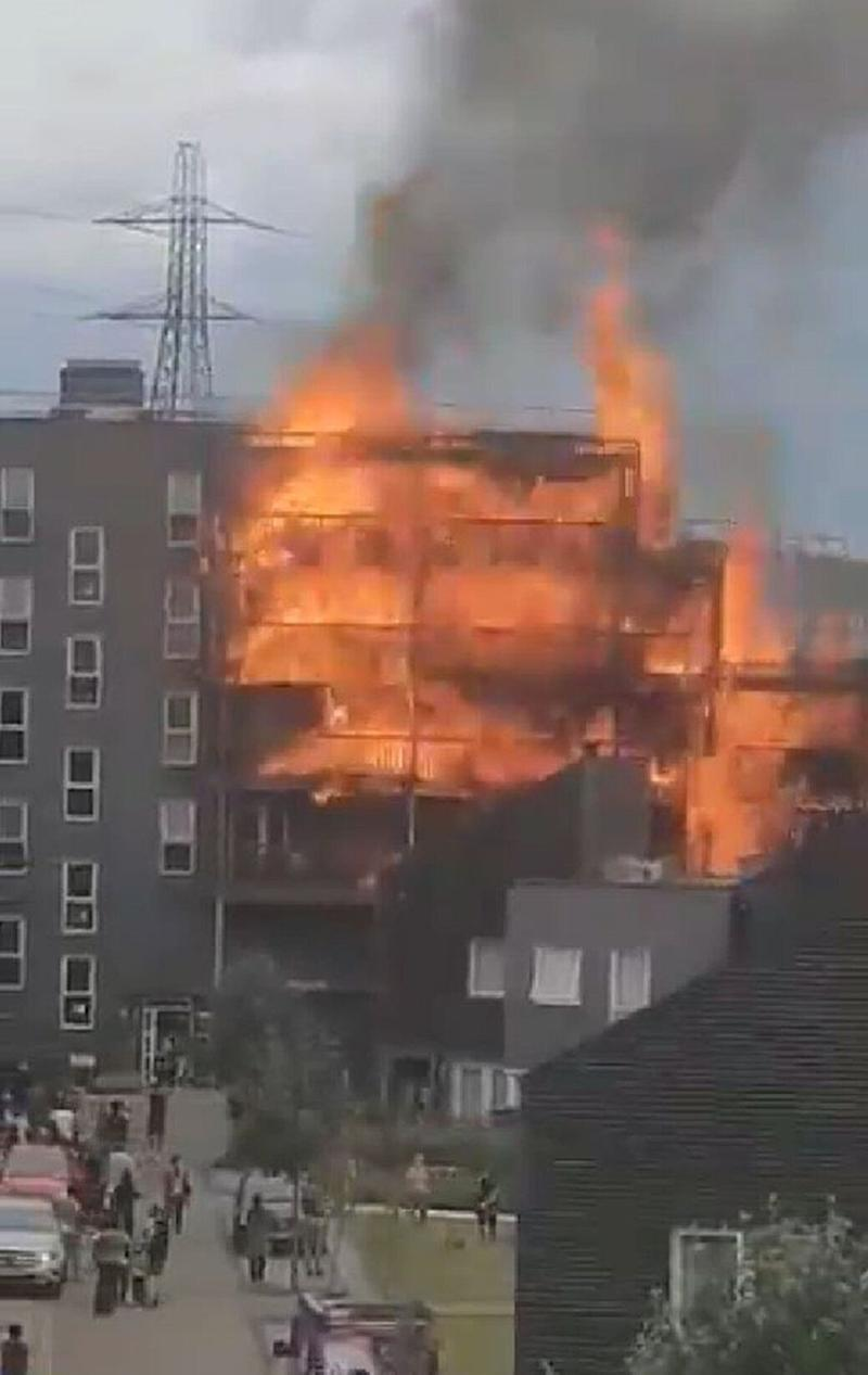 Screengrab taken with permission from a video posted by @SyeddIslam of the fire at a block of flats in Barking, east London.