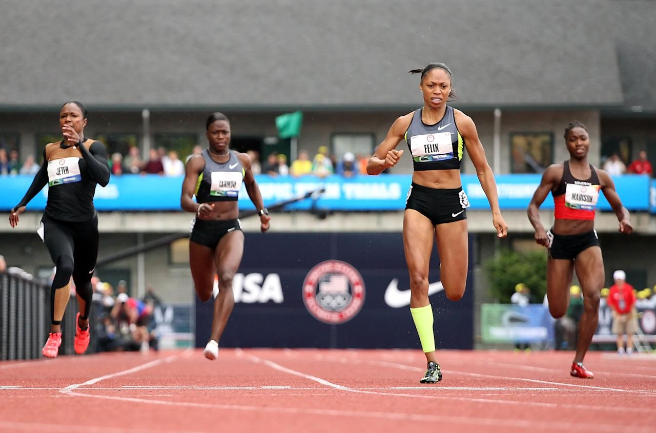 EUGENE, OR - JUNE 30:  Allyson Felix (second from right) crosses the finish line to win the Women's 200 Meter Dash Final ahead of (L-R) Carmelita Jeter, Jeneba Tarmoh and Tianna Madison on day nine of the U.S. Olympic Track & Field Team Trials at the Hayward Field on June 30, 2012 in Eugene, Oregon.  (Photo by Christian Petersen/Getty Images)