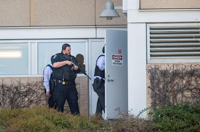 <p>Police search a building at YouTube's corporate headquarters as an active shooter situation was underway in San Bruno, California on April 03, 2018. (Photo: Josh Edelson/AFP/Getty Images) </p>