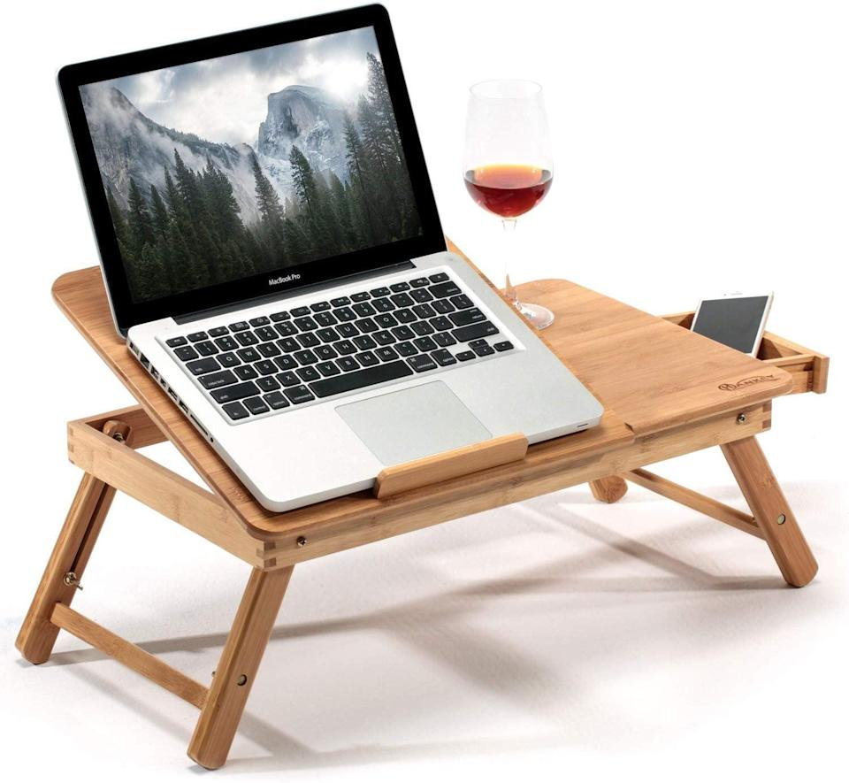 <p>This cool <span>Hankey Bamboo Large Foldable Laptop Stand Desk </span> ($28) can be used in bed or on the floor.</p>