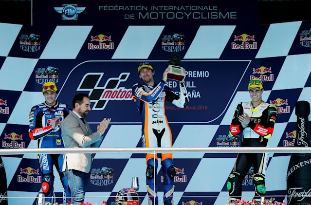 Motorcycle Racing - MotoGP - Spanish Grand Prix - Circuito de Jerez - Angel Nieto, Jerez de la Frontera, Spain - May 6, 2018 Sudmetal Schedl GP Racing's Philipp Oettl of Germany celebrates winning the Moto3 race with the trophy as Redox PruestelGP's Marco Bezzecchi of Italy celebrates second place and Bester Capital Dubai's Marcos Ramirez of Spain celebrates third REUTERS/Jon Nazca